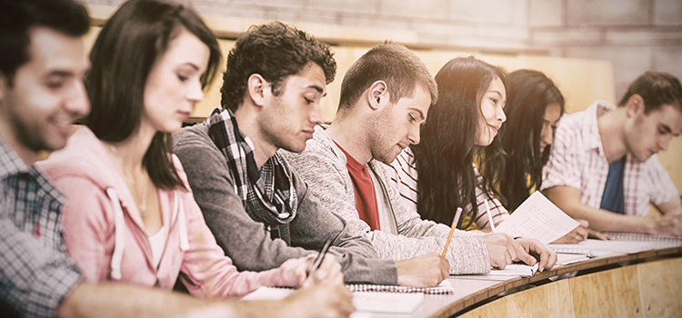 Students studying Economist